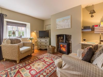 Photo for In the heart of a quiet village and in easy walking distance to the sandy beach.