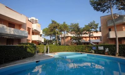 Photo for Well located apartment with pool in Lignano