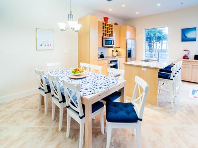Fully equipped kitchen with a view.  Table opens more to comfortably seat 8+