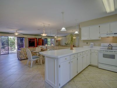 Photo for New Listing! Inviting townhouse w/huge private patio! 11 Pools, beach access!