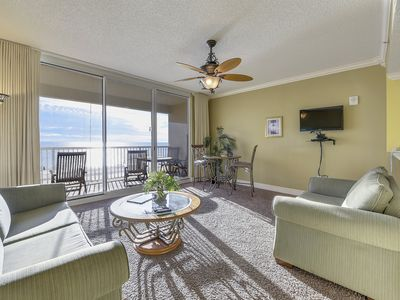 Photo for Gulf Front condo featuring a shared pool w/ a hot tub, steps to beach!