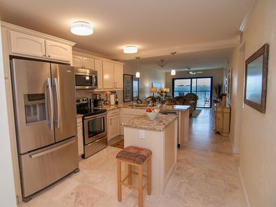 Open floor plan with kitchen opening into the living area - great water view