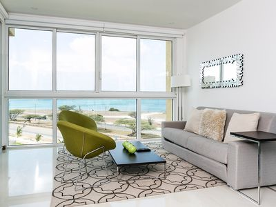 Photo for Let the sea set you free with this corner ocean view 3BDR condo. Blue-311