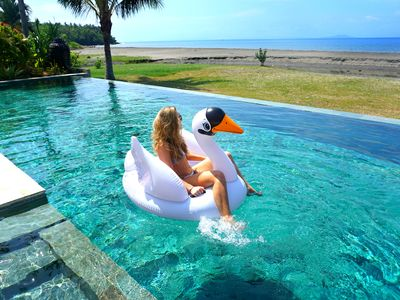 Photo for Taste the real Bali in a luxury beachfront villa