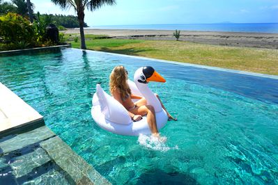 Enjoy off the big swimmingpool with amazing view off the nearby island Java