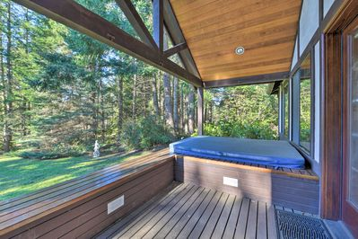 This house boasts a private hot tub and large deck!