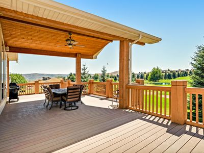 Photo for Golf course-adjacent home w/ a full kitchen, Ping-Pong, & a furnished deck