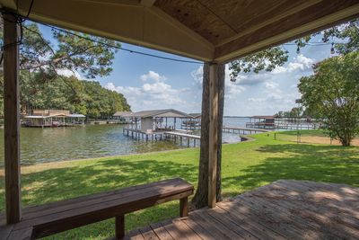 The covered porch and outdoor kitchen is a great entertaining area on the water!