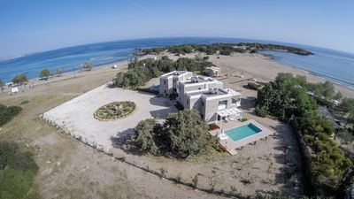 Photo for AMMOS-LUXURY BEACHSIDE STONE VILLA  -PRIVATE POOL - DIRECT ACCESS TO THE BEACH
