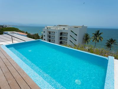 Photo for Dream Location! Walk to the beach from this beautiful condo in Bucerias. Pool overlooking ocean.