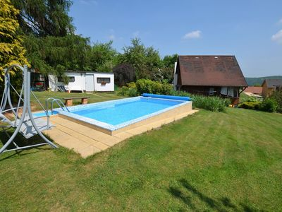 Photo for Beautiful holiday home with pool in a well-kept garden, only 35 km from Prague