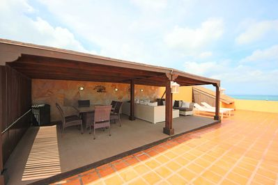 Large gazebo on the rooftop with dining and lounging area