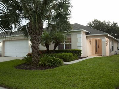 Photo for Luxury 4 Bedrooms with heated Pool at 88°, 3 miles from Disney!