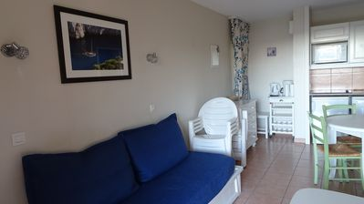 Photo for Beautiful T2 in ground garden with swimming pool, sea view, shops and beach