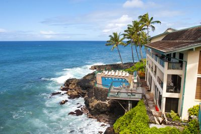 View from master lanai. - Outstanding view of the most scenic pool in Poipu with swaying palms in the background.