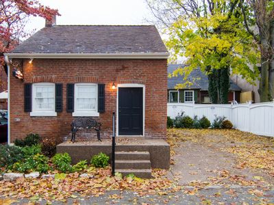 Photo for 1830's Luxury Brick Cottage, Cozy Fireplace, right off the Cobblestone Streets!