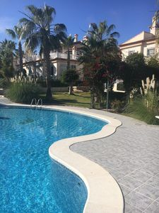 Photo for Exclusive apartment overlooking pool and beautiful landscaped gardens, Free Wifi