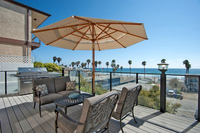 Large Stainless Steel BBQ, lounge furniture with beautiful ocean view