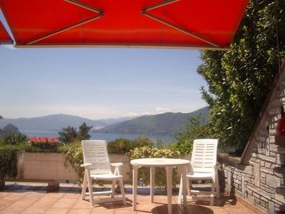 Photo for Terrace bungalow above the Lago Maggiore with a stunning lake view