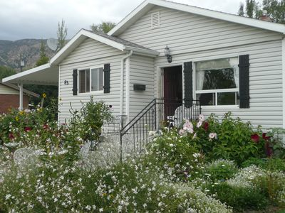 Photo for Beautiful small Garden Surrounding This Little Home. Clean and Comfortable.