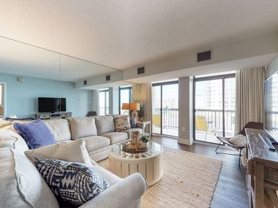 Photo for Ocean view condo w/ balcony & shared pool, tennis & game room - steps to beach!