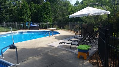 large play pool with diving board and couples bench