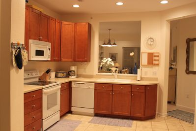 Bright kitchen is open to the dining and living space.