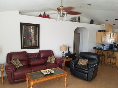 Family room with recliner, reclining couch, flat screen TV, Directv and NFL pkg.