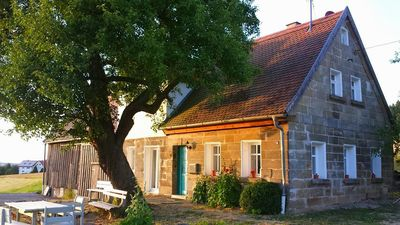 Photo for The farmhouse has been renovated from the ground up while preserving old buildings.