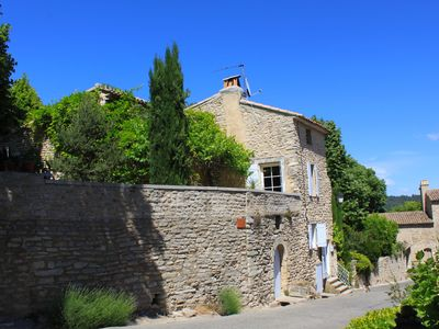 Photo for Charming village house with large plunge pool and views of the Luberon