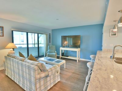 Photo for Beautiful Spacious Condo Overlooking the Bay and By the Beach
