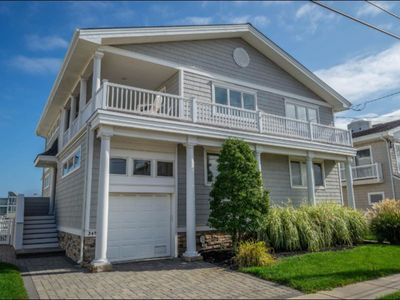 Photo for Great for swimming and all water sports. LARGE waterfront deck!!!