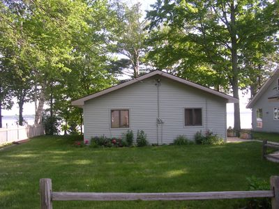 Photo for Charming Cottage on Sandy Beach with Beautiful  Lake Views from Large Deck