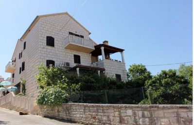 Photo for Two bedroom apartment with balcony and sea view Sutivan (Brač) (A-17537-b)