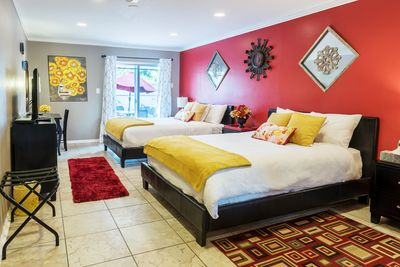 Large master bedroom #1. Comfortable dual queen beds. Large LCD TV.