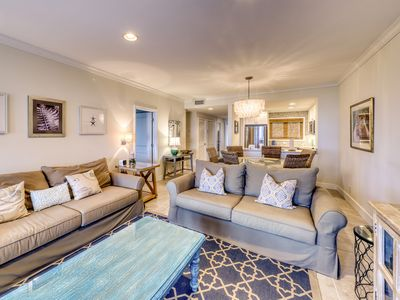 Photo for Second Floor villa w/ ocean views from deck - steps from beach for sun and sand!