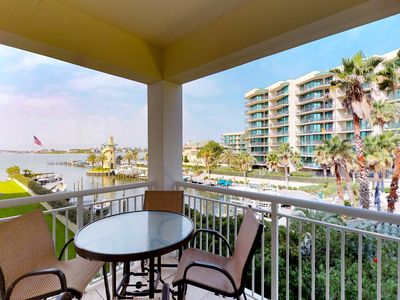 Photo for Waterfront condo features a balcony w/ great views plus a shared pool & hot tub