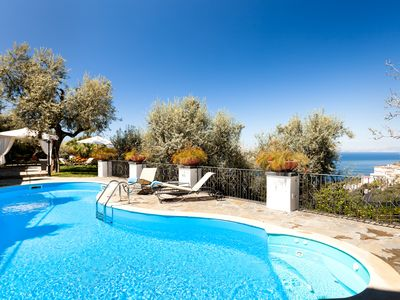 Photo for Magnificent villa with large garden, swimming pool, sea view, close to the sea,