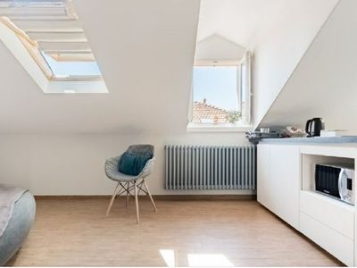 Photo for Intimate and design penthouse overlooking the Isola Madre