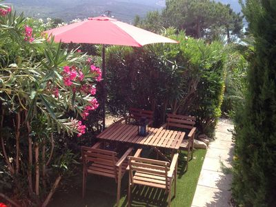 Photo for Charming Garden apartment by the sea, 150 meters from the beach.
