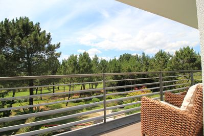 Balcony with view over the golf course
