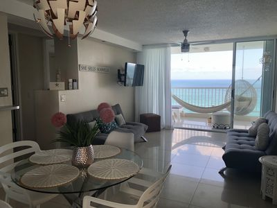 Ocean view living room with 2 sofa beds