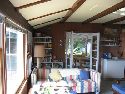 Living room; picture window. View into the porch.
