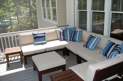 The whole family can relax on this cool sectional on the screened porch