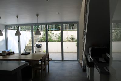 View of patio from kitchen with sliding doors closed