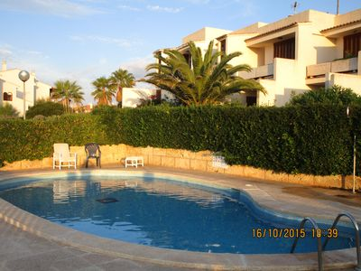 Photo for Apartment with pool + lovely views, clean, quiet, a few steps to the beach