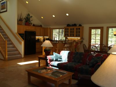 Large open living room, kitchen and dining room to relax and enjoy family