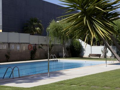 """Photo for FANTASTIC FLAT WITH POOL, NEAR THE BEACH AND THE STATION (30 """"from BCN)"""