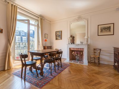 Photo for Just moments from the Eiffel Tower! Chic and spacious flat with balcony (Veeve)