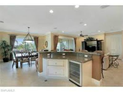Open floor plan living from Kitchen, overlooks dining, living room, and lanai.